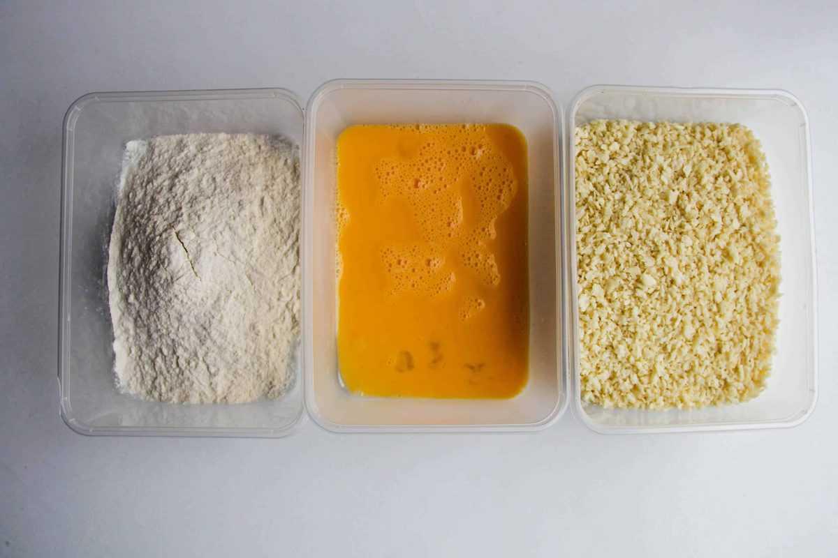 Breading the bitterballen mix in flour, eggs, then panko bread crumbs.