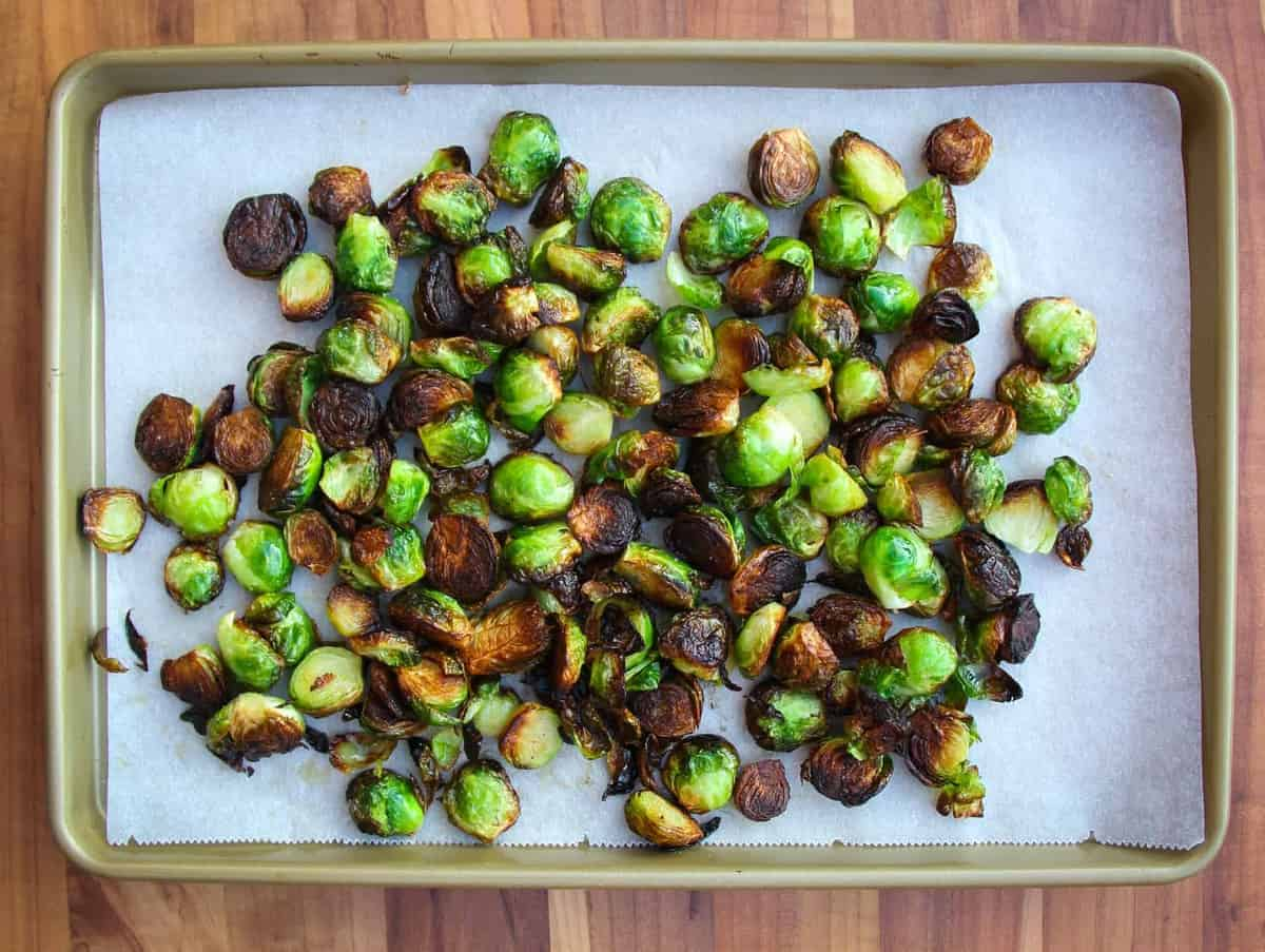 Brussel sprouts on a tray with parchment paper.