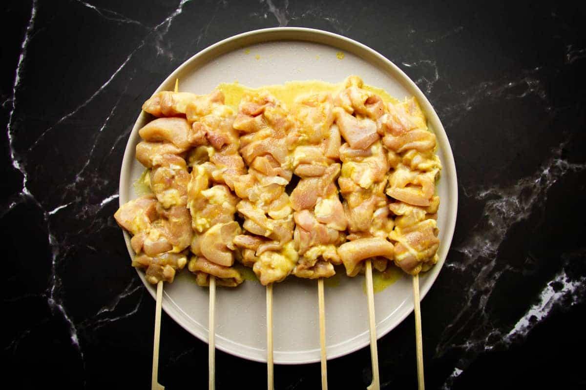 Seasoning the chicken skewers