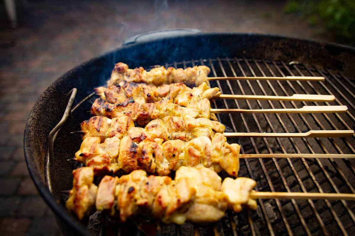 Flipping over the charcoal chicken.