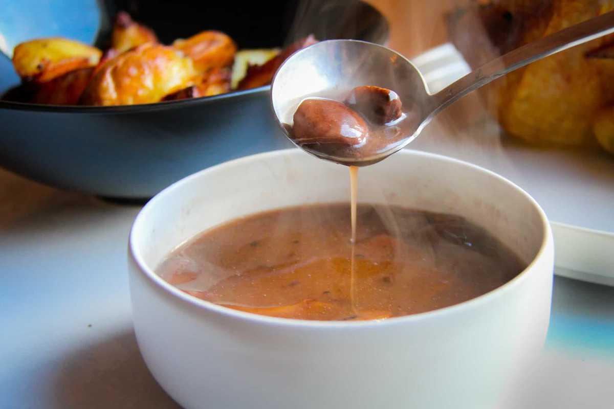 Mushroom gravy in a bowl.