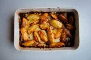 The roasted potatoes in the pan.
