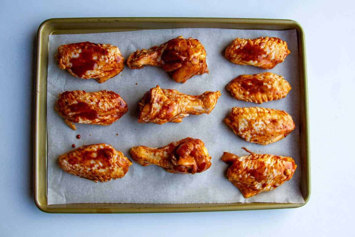 Chicken wings lined up on a tray