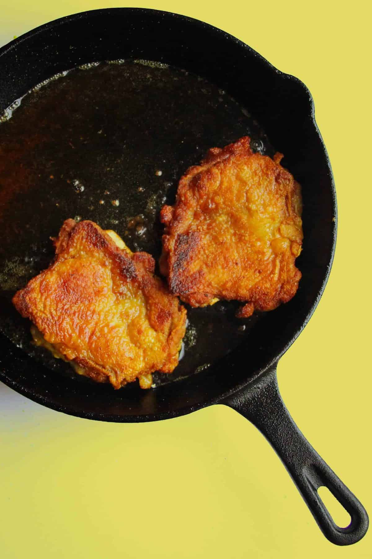 Crispy curried chicken thigh with ginger garlic spinach