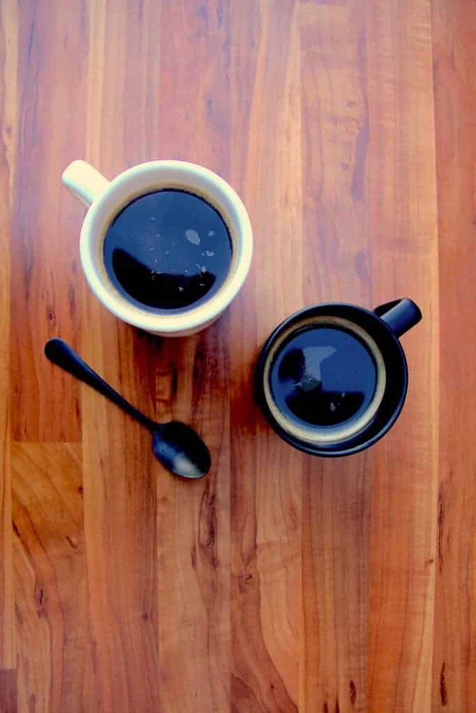 Two french press cups of coffee.