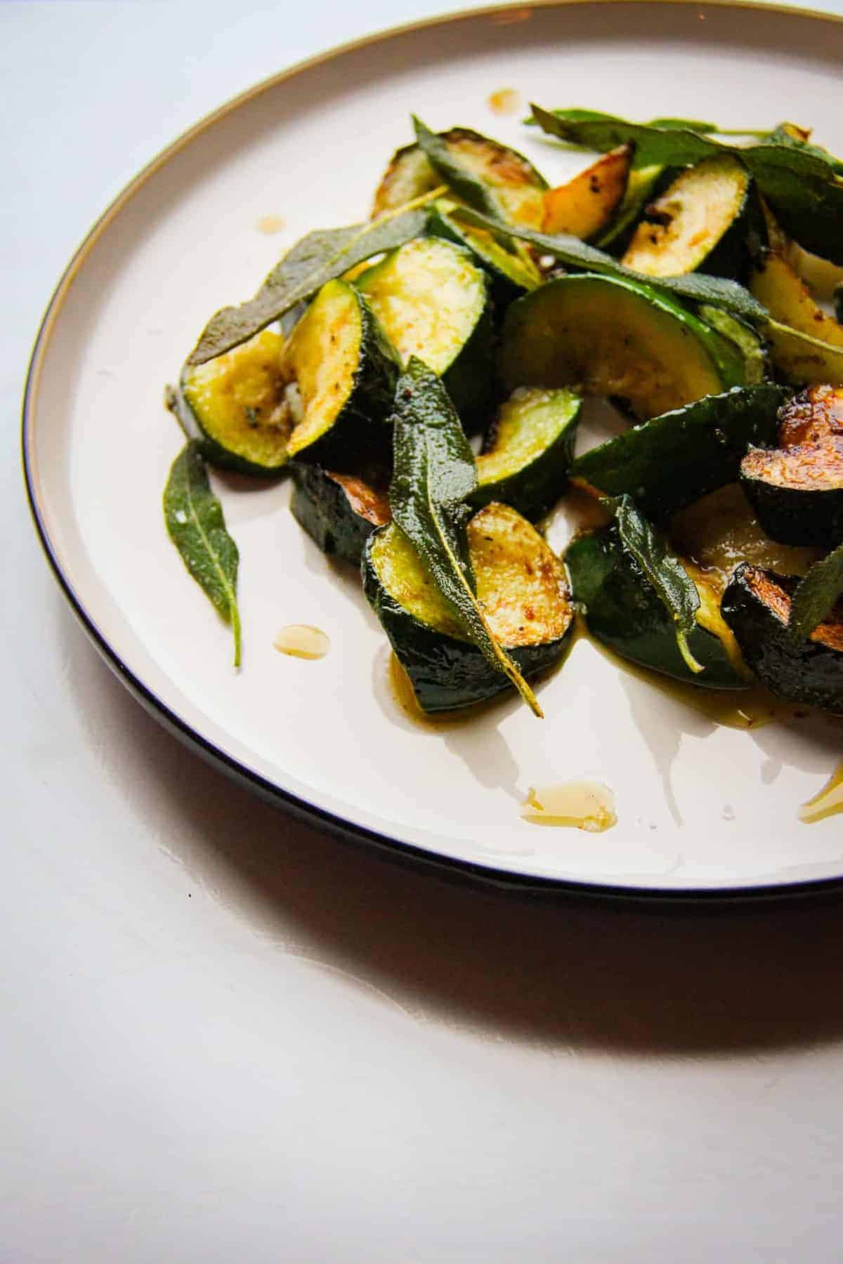 Courgette sage and garlic on a plate.