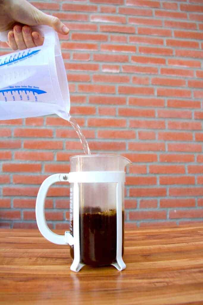 Pouring the water into the french press.