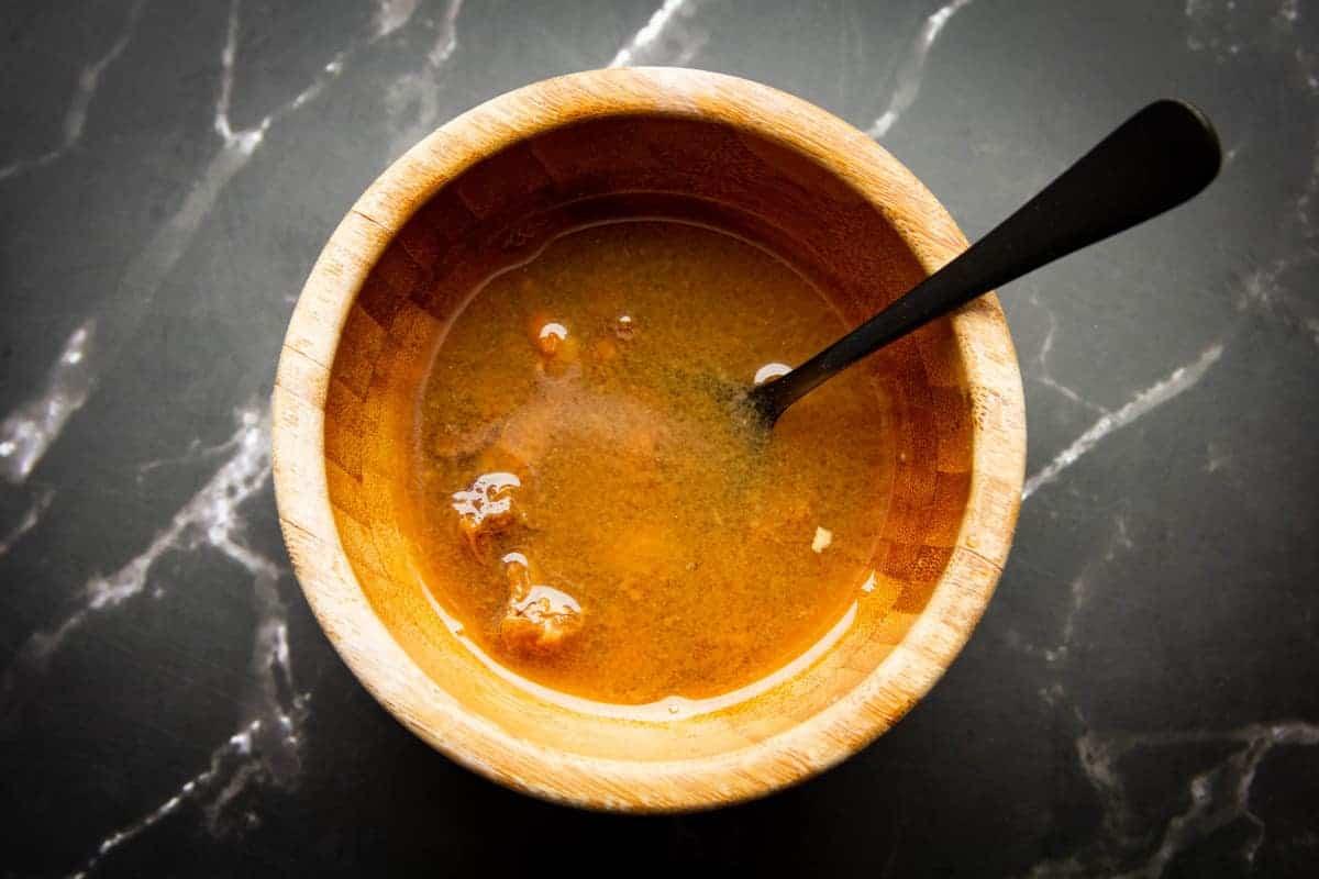 Tamarind pulp in hot water.