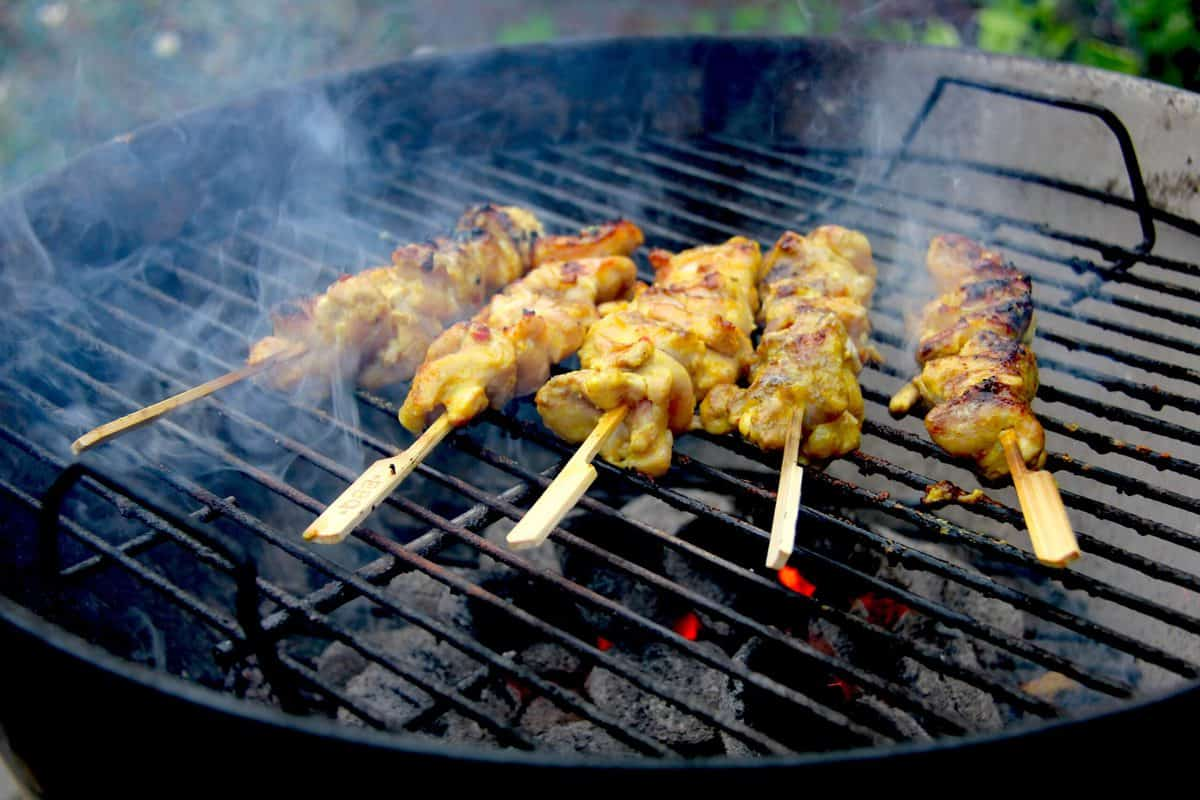 Chicken satays on the charcoal bbq.