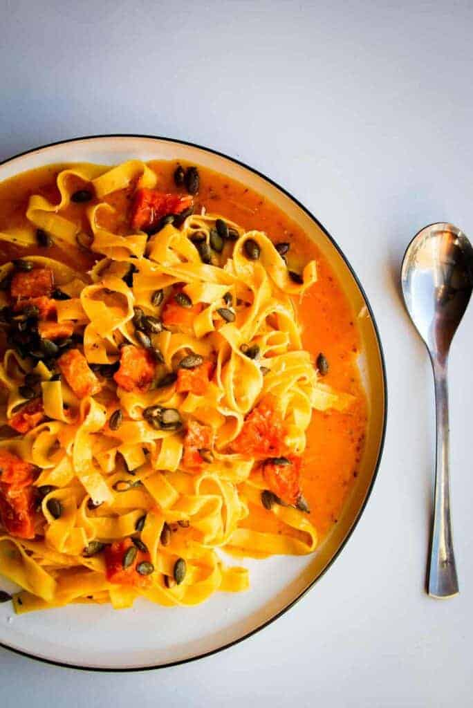 A butternut squash pasta with chili and parmigiano reggiano cheese.