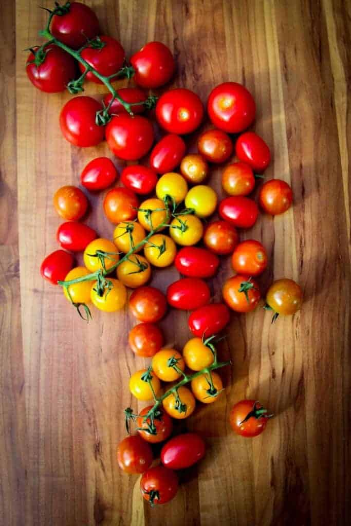 Tomatoes on a wooden board.