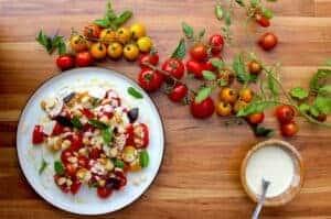 A tomato salad with fresh basil and a macadamia dressing.
