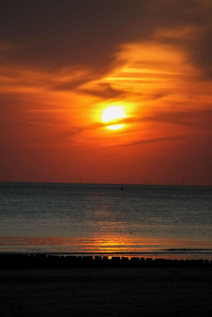 A sunset by the beach in Zeeland, the Netherlands.