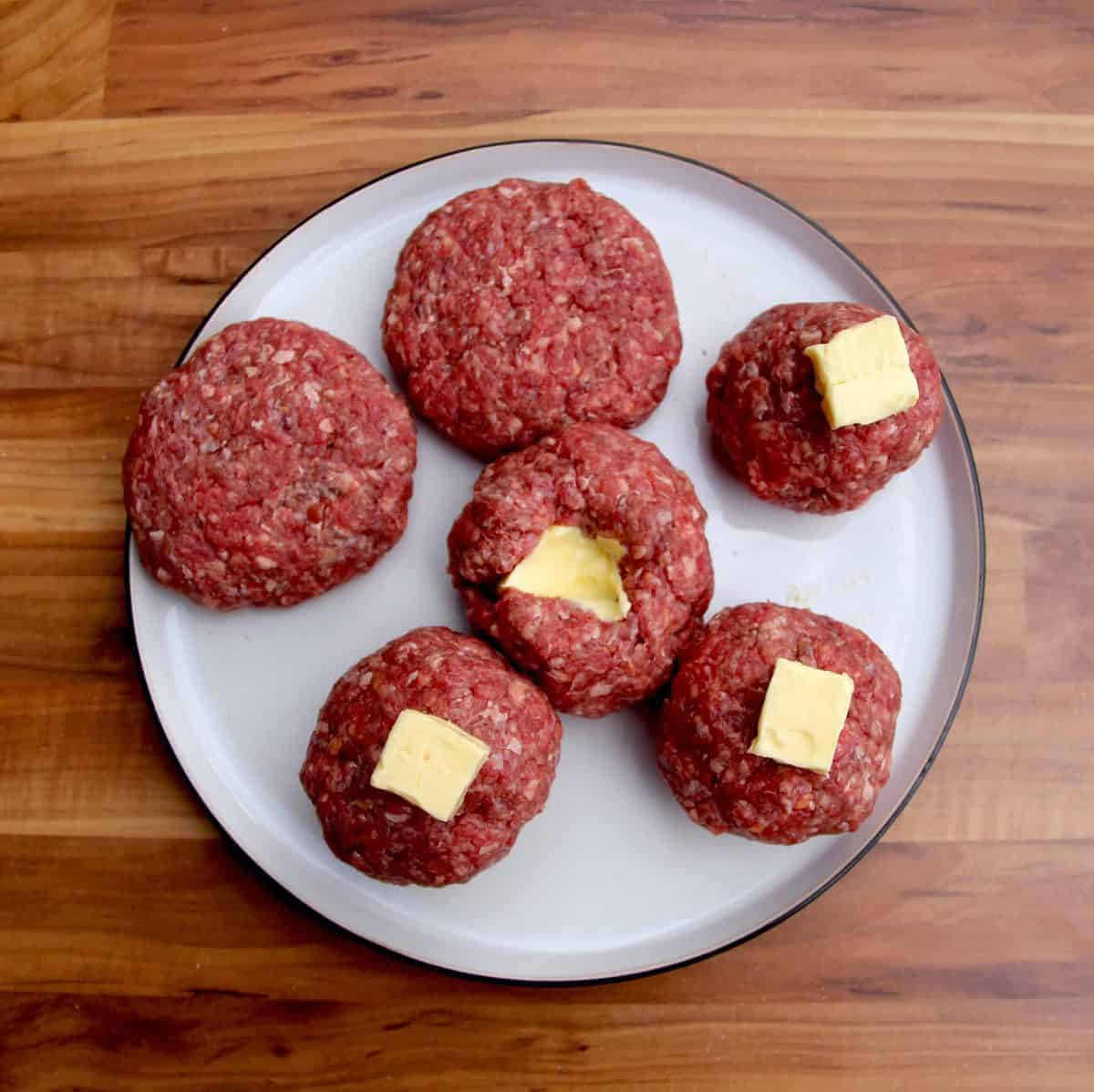 Stuffing the burgers with butter