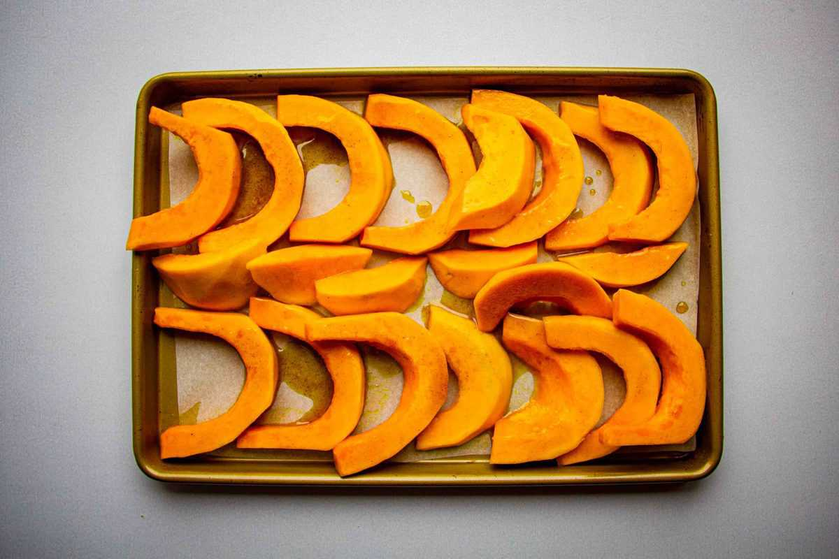 Roasting the squash on a tray.