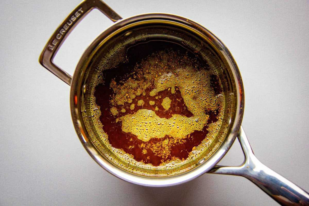 The cardamom infused oil in a saucepan