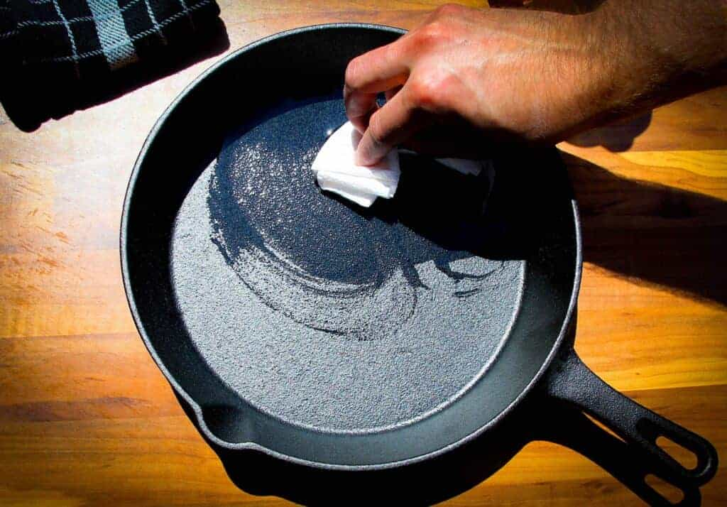 Brushing the cast iron pan with oil.