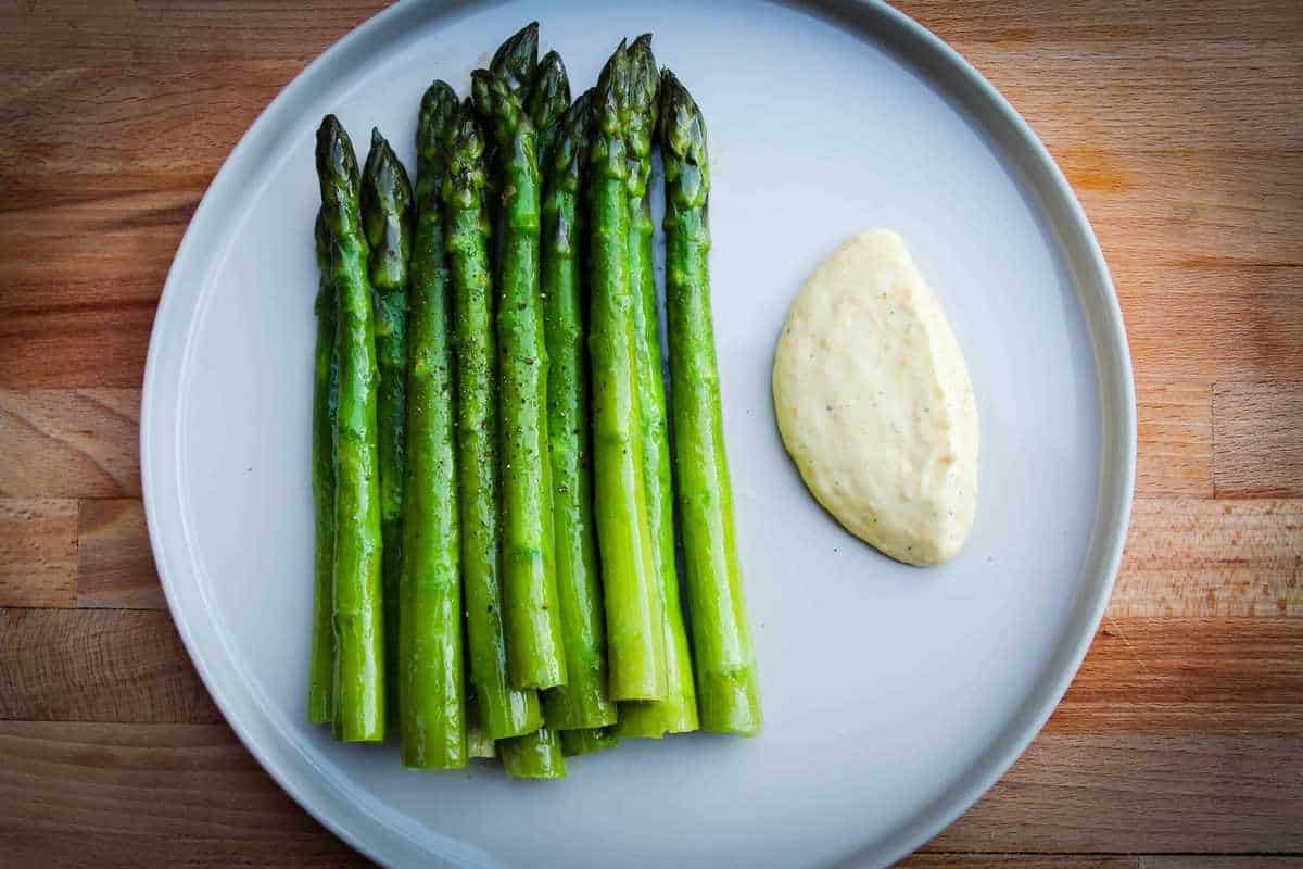 The finished green asparagus with citrus mayo.