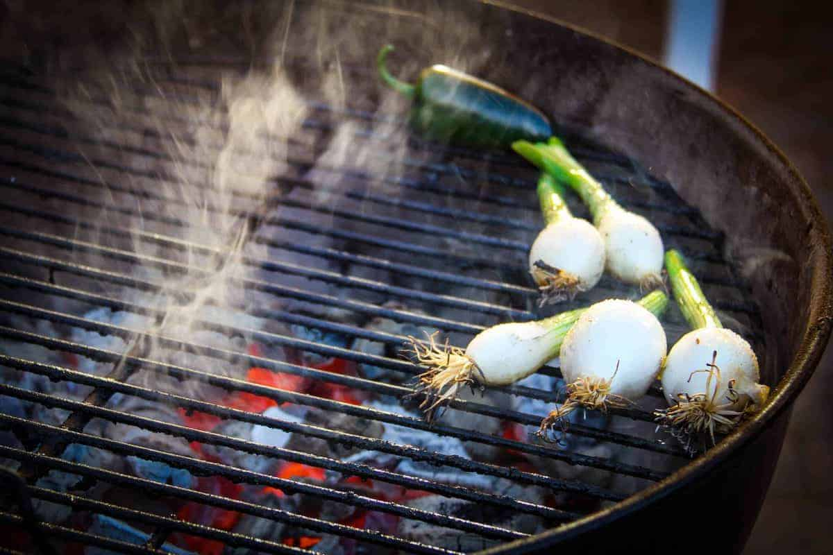 Grilling the green onions and jalapenos.