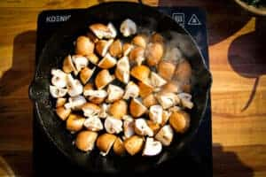Cooking the mushrooms in butter.