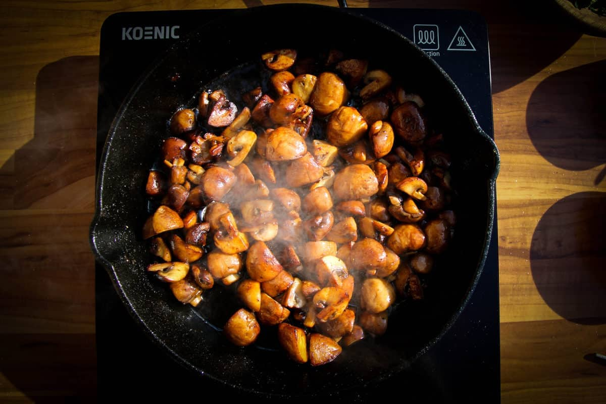 The mushrooms all nicely browned in the pan.