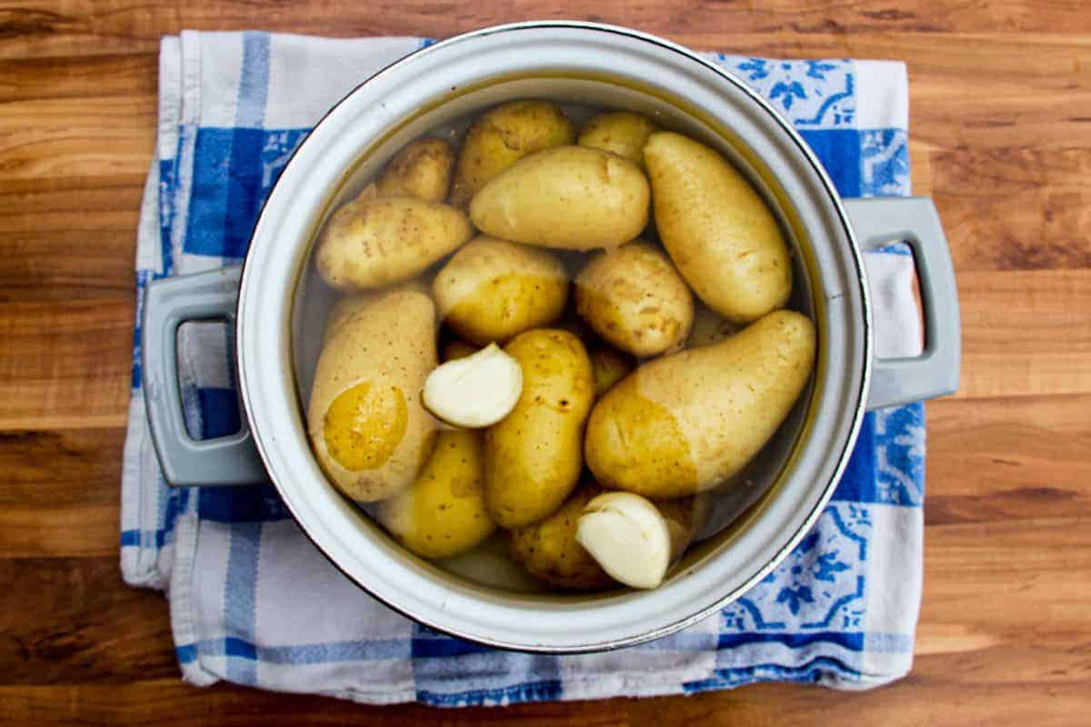 Cooking the potatoes with garlic and salt.