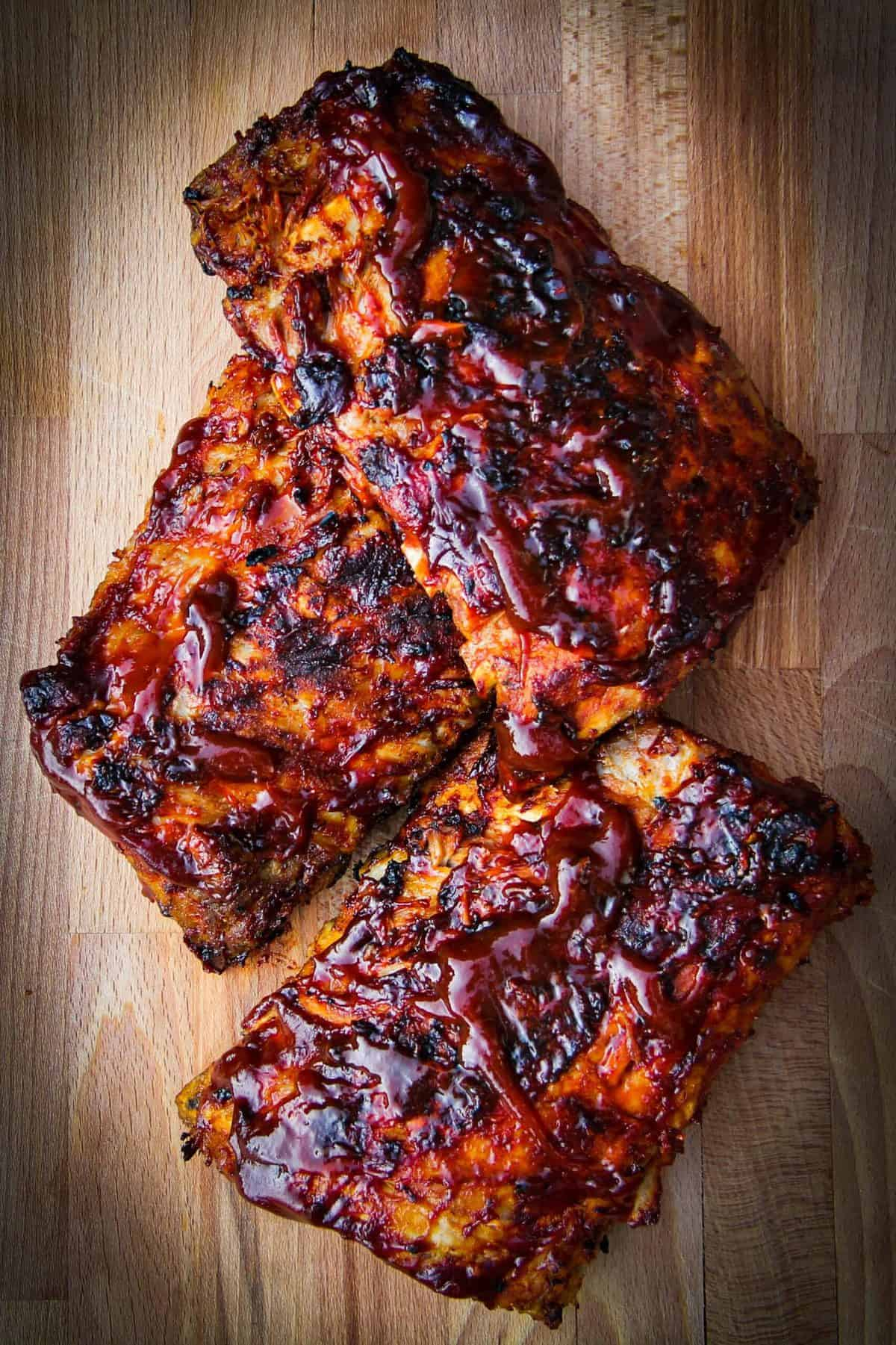 Finished ribs on a wooden board.