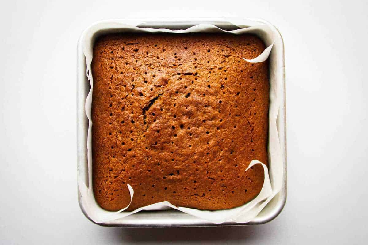 Poking holes in the baked cake
