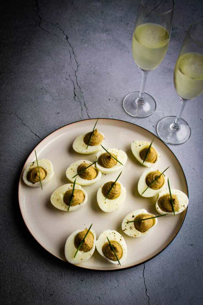 Truffled Deviled Eggs with two glasses of champagne.
