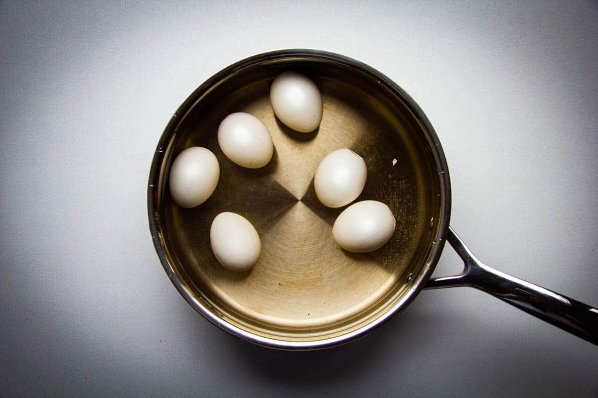 Hard boiled eggs in a pan.