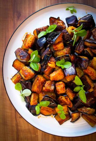 Vegan olive oil fried eggplant dish with garlic, lemon, chili and smoked paprika.