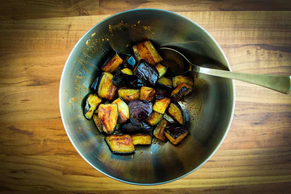 Olive oil fried eggplant in a bowl.