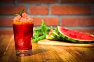 The finished watermelon granita with fresh watermelon slices on the side.