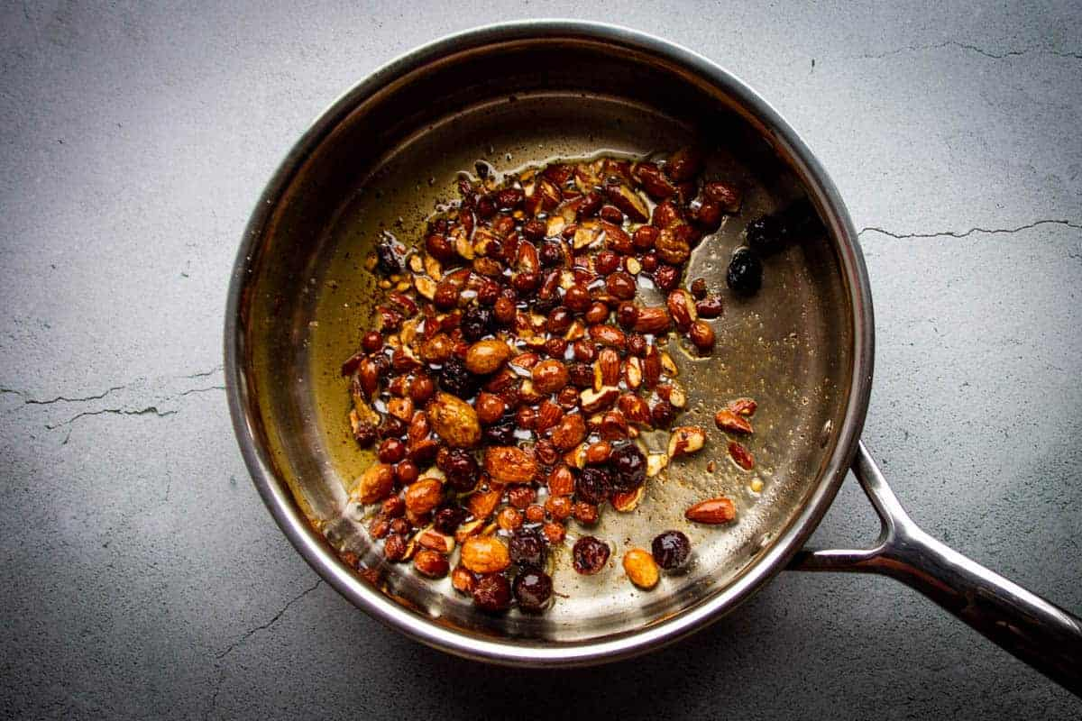 The brown butter, chili, almonds and raisins in a pan.