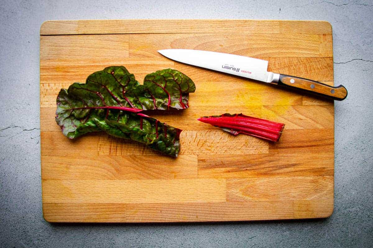 Cutting the rainbow chard stem out.