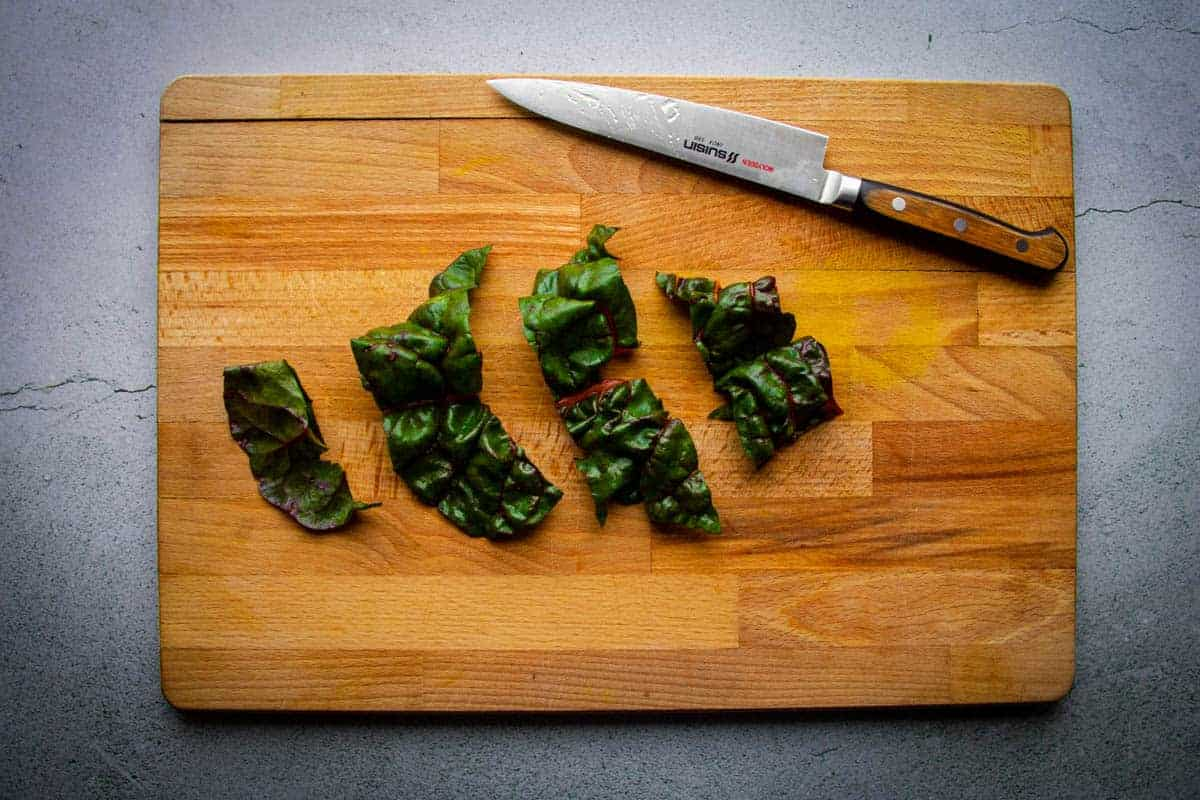 Cutting the chard into big pieces.