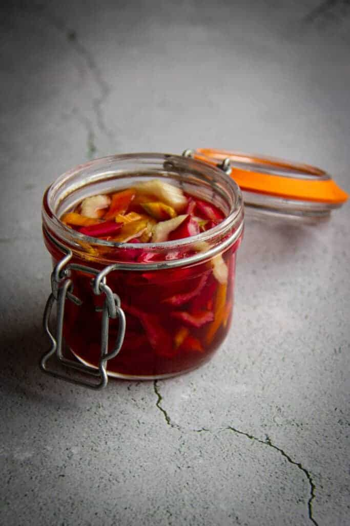 The pickled chard stems in a little mason jar.