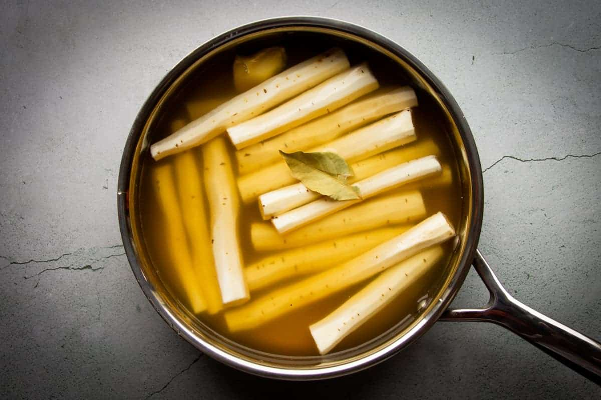 Cooking the salsify in the pan.
