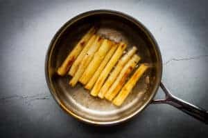 Browning the black salsify in butter.