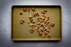 toasting the walnuts on a tray.