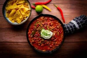 Short rib chili made in an instant pot with tortilla chips on the side.