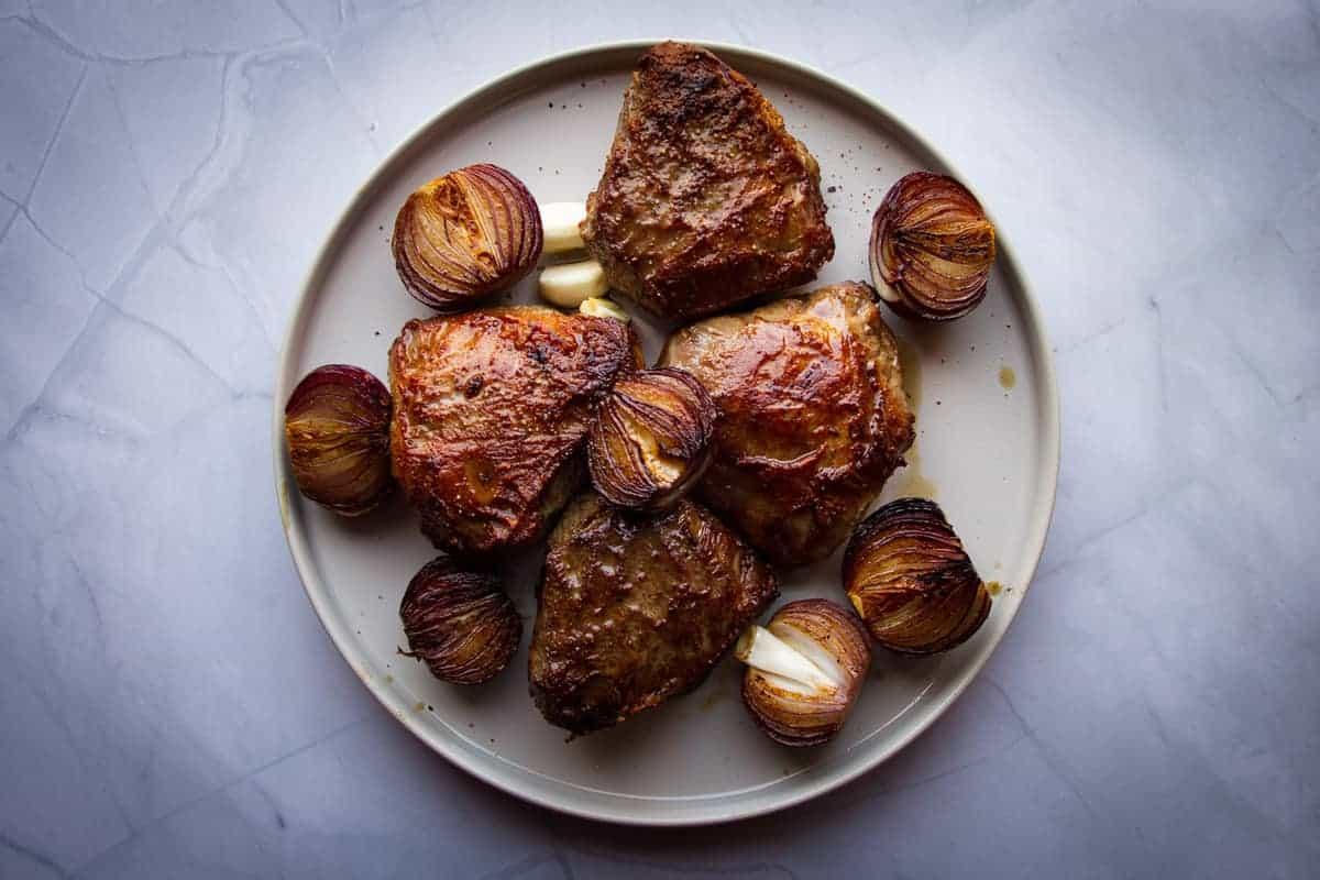 Seared beef cheeks and onions.