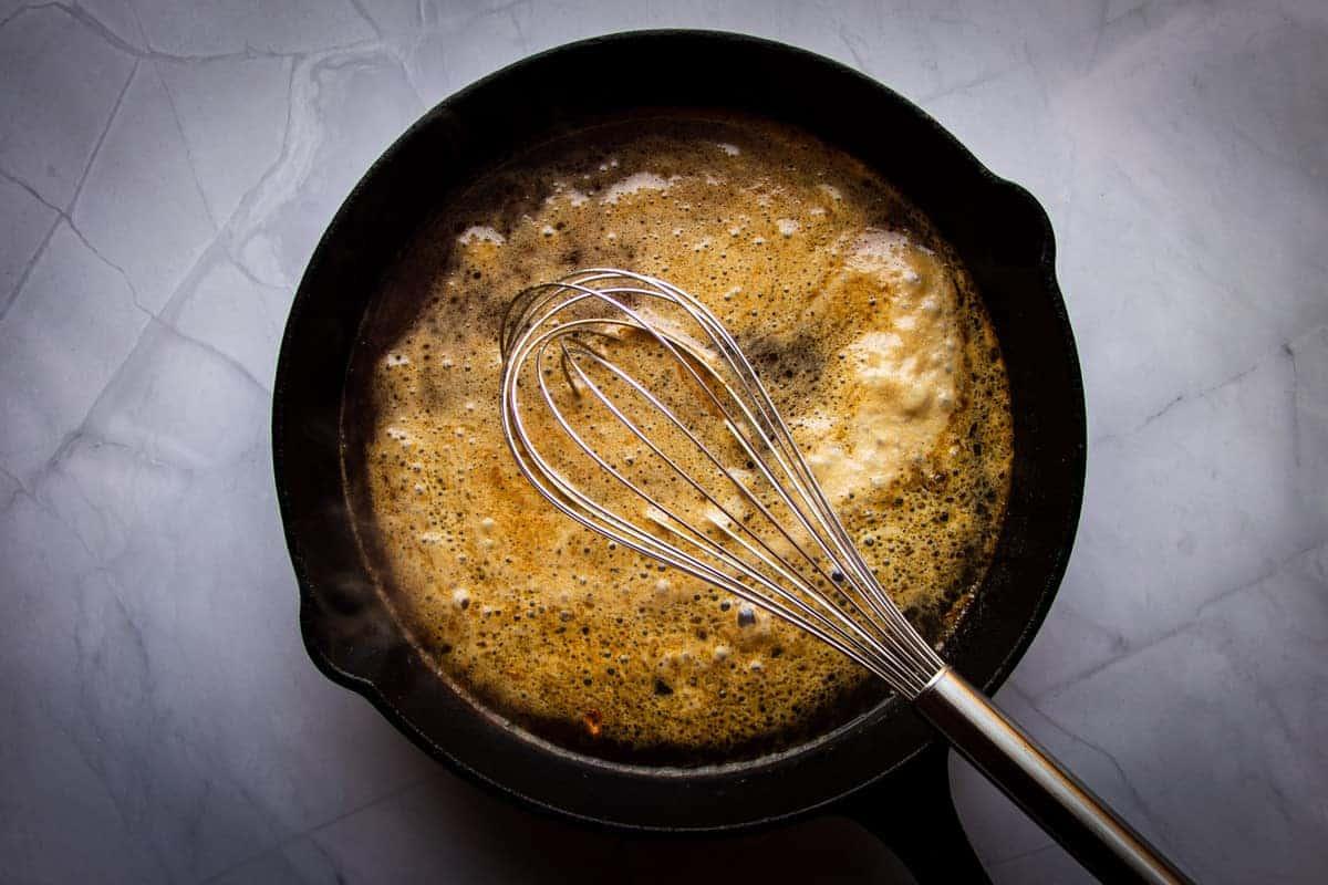 Simmering guinness sauce
