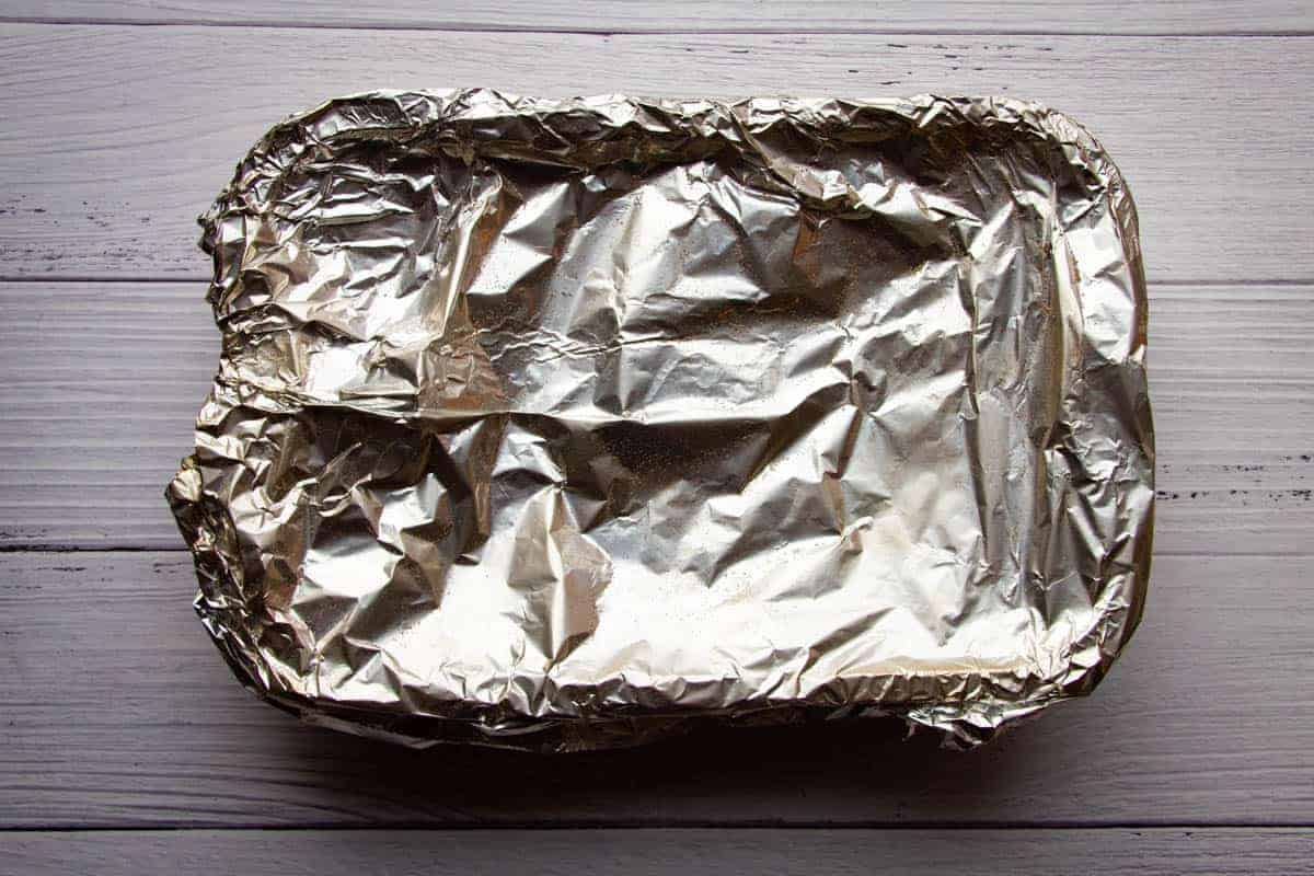 covering-the-chicken-with-a-tin-foil-lid.