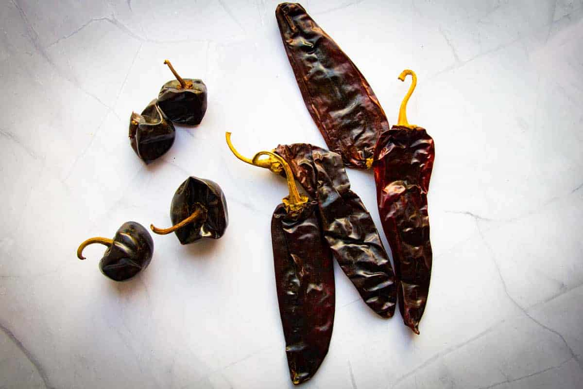 guajillo and cascabel peppers on the table.