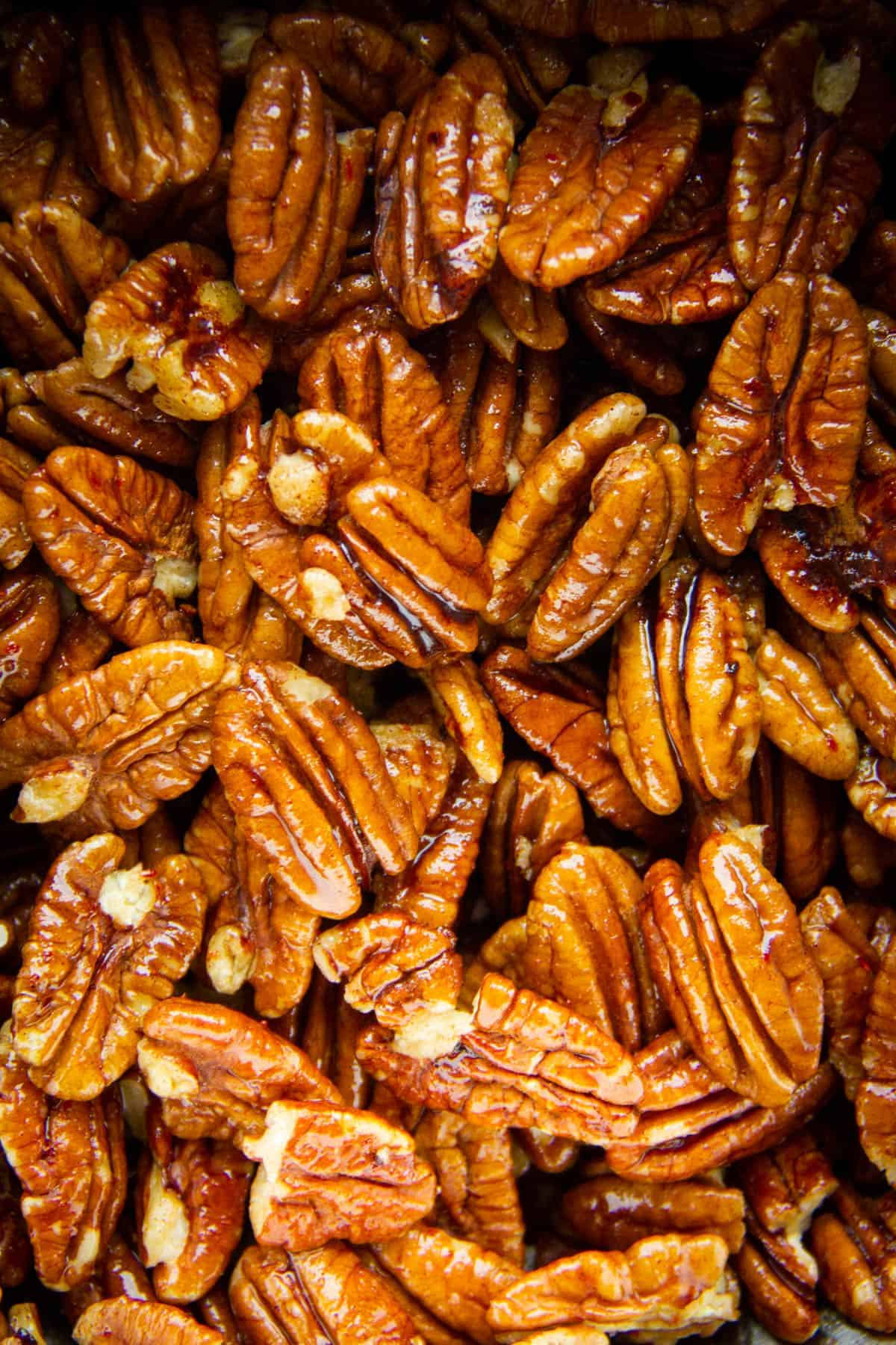A close-up of a pecans on a tray.