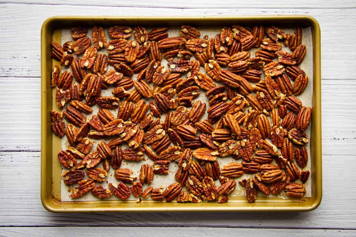 Pecan nuts on a tray ready to be baked