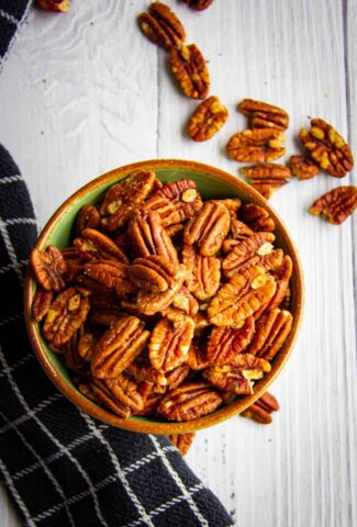 Toasted pecans in a bowl.