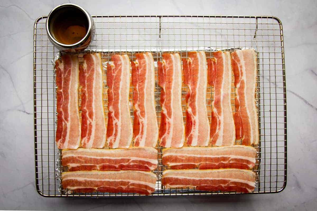 Bacon lined up on a tray.