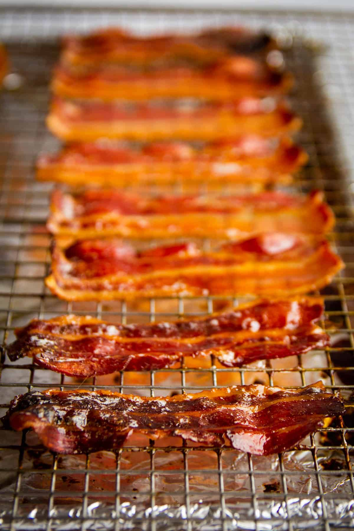 Crispy maple bacon lined up on a tray